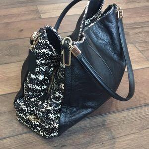 Coach black and snake skin purse.
